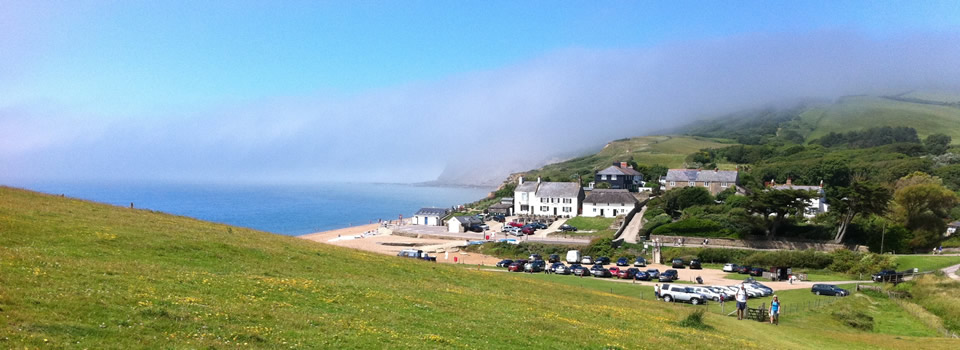 Low laying fog over Golden Cap at Seatown