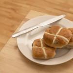Hot cross buns on a plate