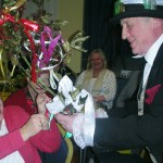 The President Linda Gould presented with rustic bouquet by the mummer Doctor as Lady of the House